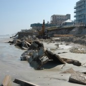 New Smyrna Beach, FL, October 27, 2004 -- The destruction of this seawall and the erosion behind was caused by the storm surge and wave action of Hurricane Jeanne.  FEMA Photo/Mark Wolfe